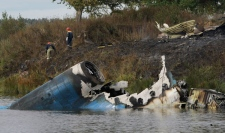 Rescuers seen at the crash site of Russian Yak-42 jet near the city of Yaroslavl, on the Volga River about 240 km northeast of Moscow, Russia, Wednesday, Sept. 7, 2011. (AP / Misha Japaridze)