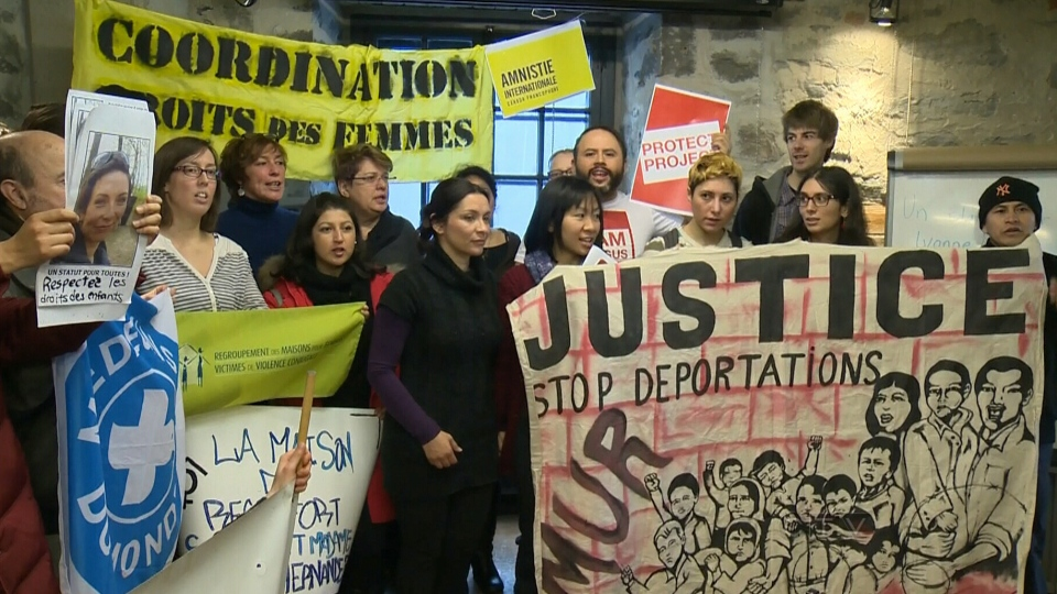 A group gathers to protest the deportation of Ivonne Hernandez in Montreal on Monday, Feb. 3, 2014.