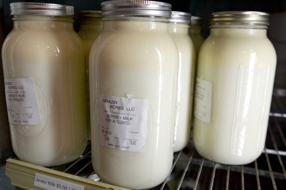 Bottles of raw milk are photographed on June 3, 2010 near Loganville, Wis. (AP / Wisconsin State Journal, Kyle McDaniel)