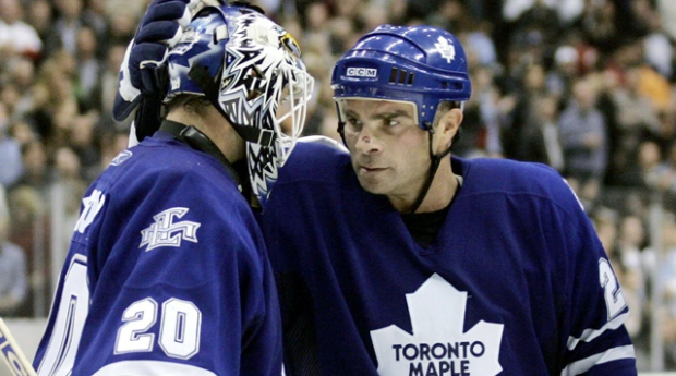 a0ac1eaf55c Toronto Maple Leafs netminder Ed Belfour celebrates with forward Tie Domi  during NHL action against the Florida Panthers on Monday Oct. 31
