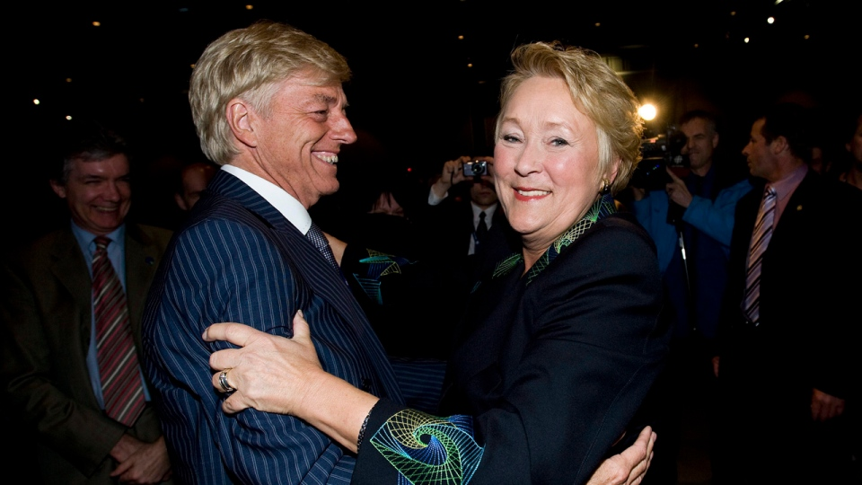 In this file photo, Parti Quebecois leader Pauline Marois greets her husband Claude Blanchet as she arrives at a PQ convention in Montreal, Friday, April 15, 2011, prior to giving her opening address. The CANADIAN PRESS/Graham Hughes