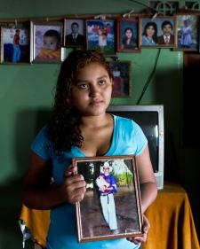 Fatima Alvarenga holds photo of dad in El Salvador
