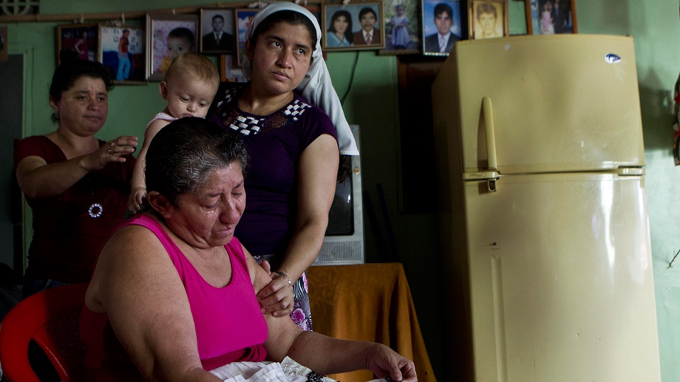 Maria Alvarenga, the mother of Jose Salvador Alvarenga, is comforted by relatives during an interview inside her home in the village of Garita Palmera, El Salvador, Tuesday, Feb. 4, 2014. (AP / Esteban Felix)