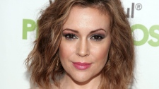 Actress Alyssa Milano attends the Maxim Magazine Super Bowl Party in New York on Saturday, Feb. 1, 2014. (Andy Kropa/Invision)