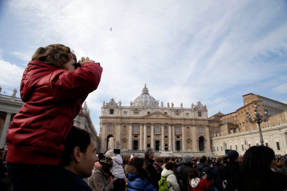 A child uses binoculars to watch Pope Francis delivering the Angelus from a window of the Apostolic palace in St. Peter's Square, at the Vatican, Sunday, Jan. 12, 2014. (AP / Gregorio Borgia)
