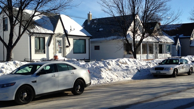 Winnipeg police, shown here on Redwood Avenue, conducted raids at several locations across the city on Feb. 5, 2014.