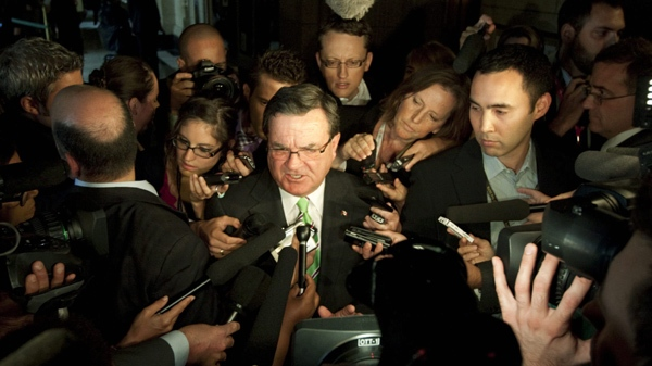Finance Minister Jim Flaherty talks to reporters before the start of the Conservative caucus meeting on Parliament Hill, in Ottawa, Thursday September 8 2011. (Fred Chartrand / THE CANADIAN PRESS)