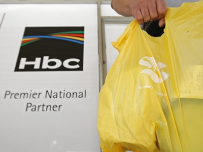 A man carries a bag with his purchases as he leaves The Bay department store in Vancouver, B.C., on Wednesday July 16, 2008. (Darryl Dyck / THE CANADIAN PRESS)