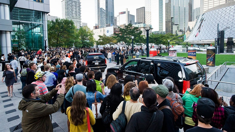 Crowds of U2 fans flock to greet Bono and The Edge before the screening of the U2 film 'From The Sky Down' during opening night of the Toronto International Film Festival at Roy Thompson Hall in Toronto, Sept. 8, 2011. (Aaron Vincent Elkaim / THE CANADIAN PRESS)