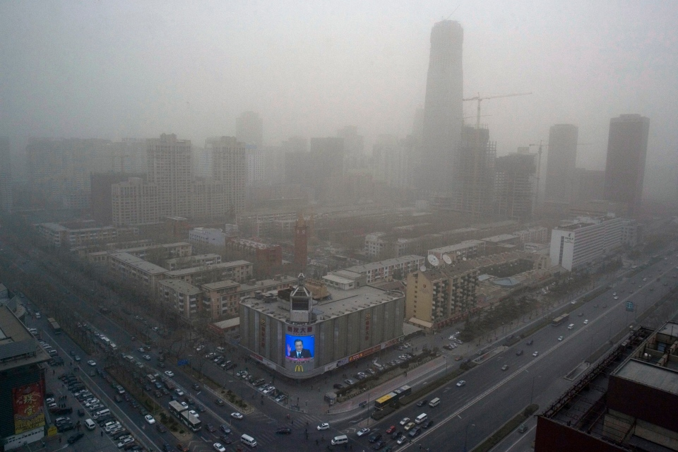 In this March 18, 2008 file photo, Chinese Premier Wen Jiabao's press conference is telecast live on a mall screen during a day of severe air pollution in Beijing. (AP Photo/Ng Han Guan, File)
