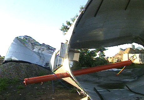 Two steel grail cylinders that were reinforced in concrete lay damaged after being ripped out by the tornado near Vulcan, Alta., on Tuesday, July 15, 2008.