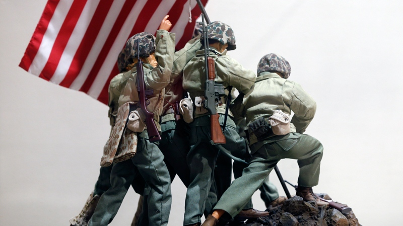 In this Jan. 31, 2014 photo, G.I. Joe action figures portray Raising the Flag on Iwo Jima in a display at the New York State Military Museum in Saratoga Springs, N.Y.  (AP Photo/Mike Groll)