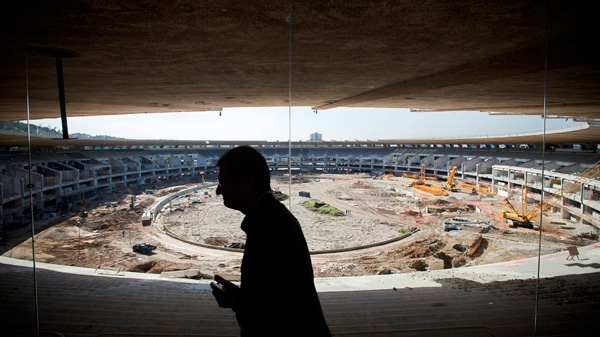 A delegate of the International Olympic Committee visits the Maracana stadium that is undergoing renovation ahead of the Rio Olympics 2016 in Rio de Janeiro, Brazil, Wednesday June 8, 2011. (AP / Victor R. Caivano)