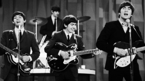 "In this Feb. 9, 1964 file photo, The Beatles , from left, Paul McCartney, Ringo Starr on drums, George Harrison and John Lennon, perform on the CBS ""Ed Sullivan Show"" in New York. (AP Photo/Dan Grossi/ File)"