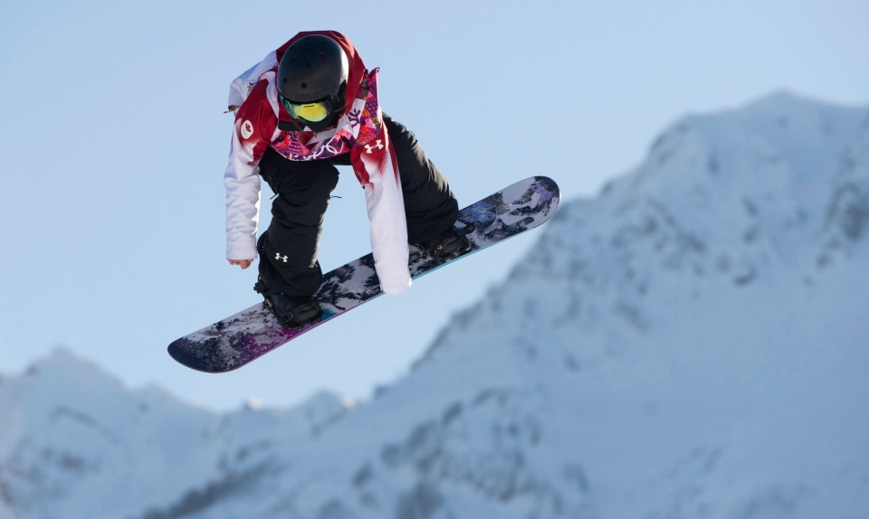 Jenna Blasman of Canada flies through the air during a qualification run of the slopestyle snowboard competition at the Sochi Winter Olympics in Krasnaya Polyna, Russia, Thursday, Feb. 6, 2014. (Jonathan Hayward / THE CANADIAN PRESS)