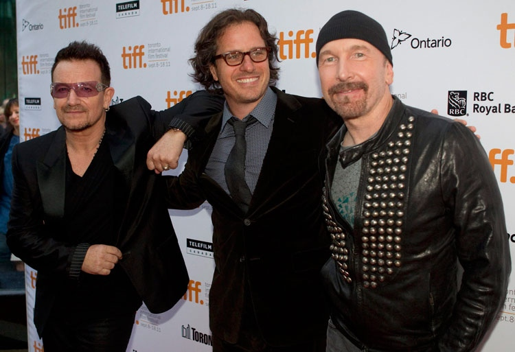 Bono, director Davis Guggenheim and The Edge pose for a photo as they arrive at the gala for the U2 doc 'From the Sky Down' which opens the 2011 Toronto International Film Festival on Thursday, Sept. 8, 2011. (Chris Young / THE CANADIAN PRESS)
