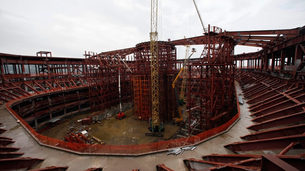 In this photo taken Friday, May 20, 2011, the Grand Ice Palace is under construction in the Black Sea resort of Sochi, southern Russia. Sochi will host the 2014 Winter Olympics. (AP / Alexander Zemlianichenko)