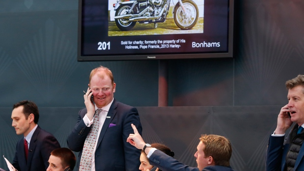 Pope s francis harley davidson fetches 327 000 at charity auction in