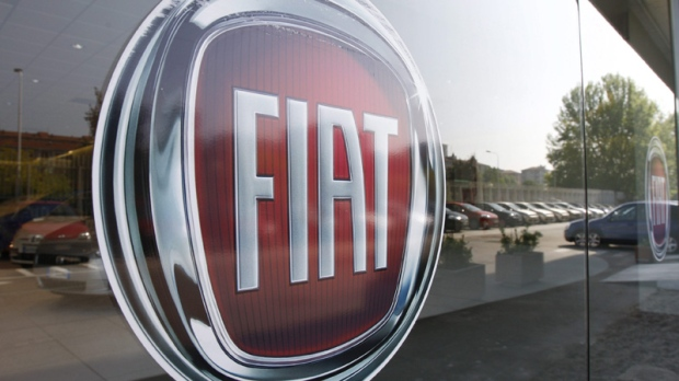 In this May 7, 2009 file photo, a Fiat logo is seen on a car retailer's window in Milan, Italy. (AP Photo/Luca Bruno, File)