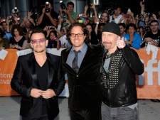 Bono, director Davis Guggenheim and The Edge attend the opening night gala screening of 'From The Sky Down' at Roy Thompson Hall during the Toronto International Film Festival on Thursday, Sept. 8, 2011. (AP / Evan Agostini)