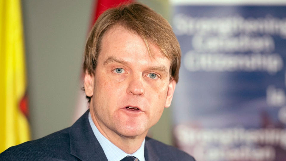 Canada's Citizenship and Immigration Minister Chris Alexander speaks after unveiling changes to Canada's Citizenship Act in Toronto on Thursday, Feb. 6, 2014. (Frank Gunn/ THE CANADIAN PRESS)