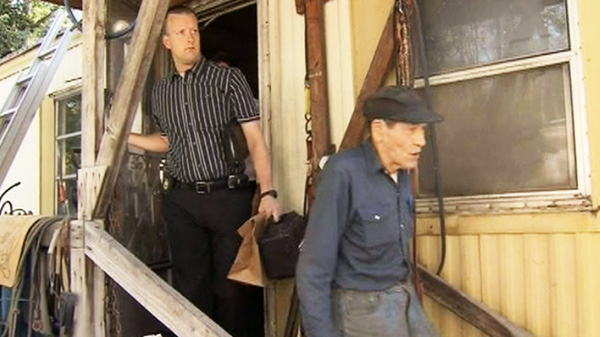 Police search the trailer of Peter Hopley on Friday, Sept. 9, 2011.