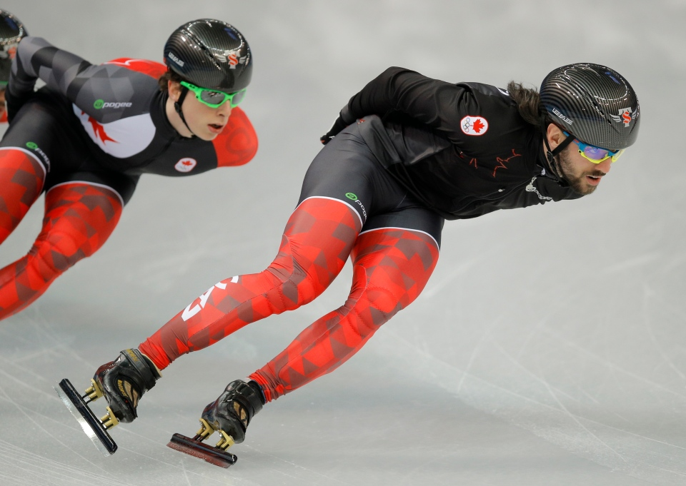 Charles Hamelin of Canada, right, trains during a short track speedskating practice session at the Iceberg Skating Palace ahead of the 2014 Winter Olympics, Thursday, Feb. 6, 2014, in Sochi, Russia. (AP / Vadim Ghirda)