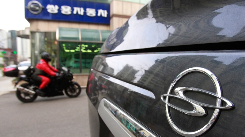 Ssangyong Motor Co. emblem is seen on its car in front of the company's showroom in Seoul, South Korea, Friday, Feb. 7, 2014. (AP Photo/Ahn Young-joon)