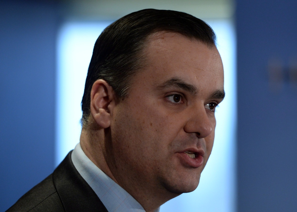 Industry Minister James Moore makes an announcement in Ottawa on Feb. 5, 2014., regarding Canada's wireless industry. (Sean Kilpatrick / THE CANADIAN PRESS)