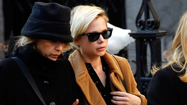 Actress Michelle Williams, right, arrives at the Church of St. Ignatius Loyola for the private funeral of actor Philip Seymour Hoffman Friday, Feb. 7, 2014, in New York. Hoffman, 46, was found dead Sunday of an apparent heroin overdose. (AP Photo/Jason DeCrow)