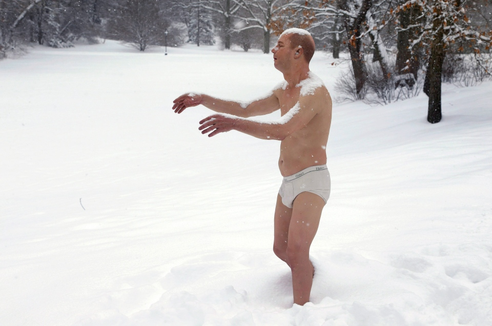 A statue of a man sleepwalking in his underpants is surrounded by snow on the campus of Wellesley College, in Wellesley, Mass., Wednesday, Feb. 5, 2014. (AP / Steven Senne)