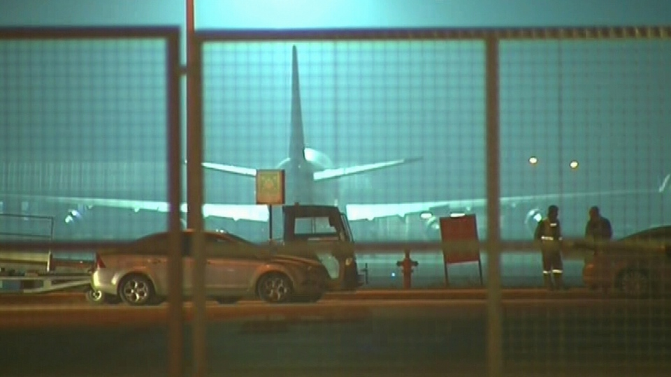 A Pegasus Airlines flight sits on the tarmac at Istanbul's Sabiha Gokcen after a passenger claiming there was a bomb on board tried to divert an Istanbul-bound plane to Sochi, Friday, Feb. 7, 2014.