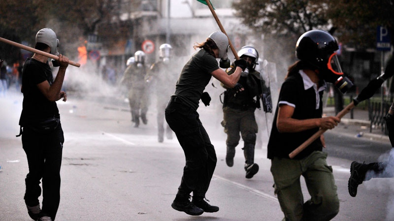 Protesting taxi drivers confront riot police during a demo in Thessaloniki, Greece, on Saturday Sept. 10, 2011. (AP / Giorgos Nissiotis)
