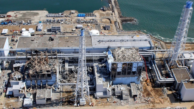 An aerial photo taken by a small unmanned drone and released by AIR PHOTO SERVICE, damaged Unit 3, left, and Unit 4 of the crippled Fukushima Dai-ichi nuclear power plant are seen in Okuma, Fukushima prefecture, northeastern Japan on March 24, 2011. (AP / AIR PHOTO SERVICE)