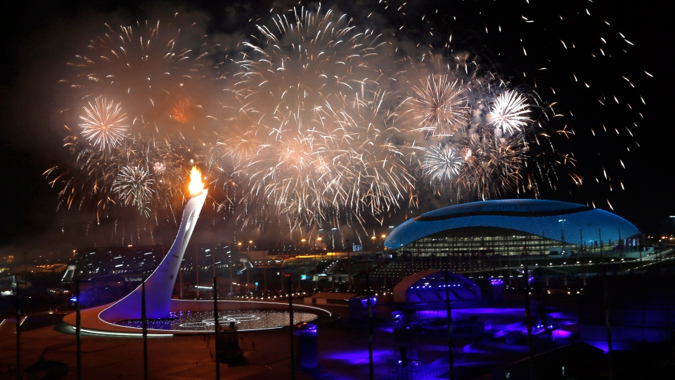 Fireworks explode over the Olympic Park during the opening ceremony of the 2014 Winter Olympics in Sochi, Russia, Friday, Feb. 7, 2014. (AP / Julio Cortez)