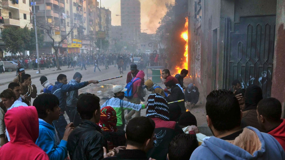 Supporters of Egypt's ousted President Mohammed Morsi damage a police building in Cairo's Ain Shams district, Egypt, Friday, Feb. 7, 2014. (AP / Mostafa Darwish)