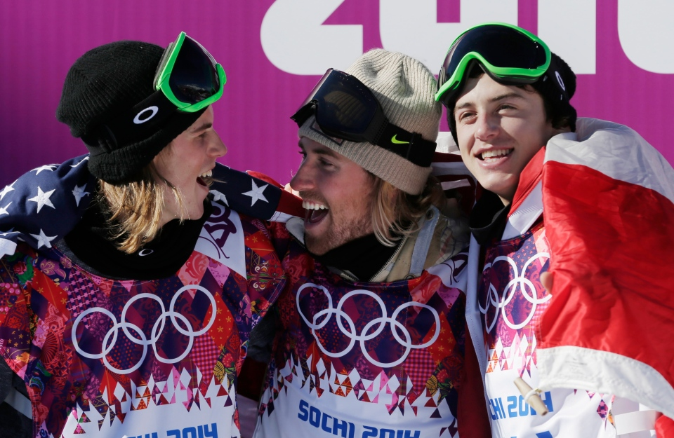 United States' Sage Kotsenburg, centre, celebrates with Norway's Staale Sandbech, left, and Canada's Mark McMorris after Kotsenburg won the men's snowboard slopestyle final at the Rosa Khutor Extreme Park, at the 2014 Winter Olympicss in Krasnaya Polyana, Russia, Saturday, Feb. 8, 2014. Sandbech took the silver medal and McMorris took bronze. (AP / Andy Wong)