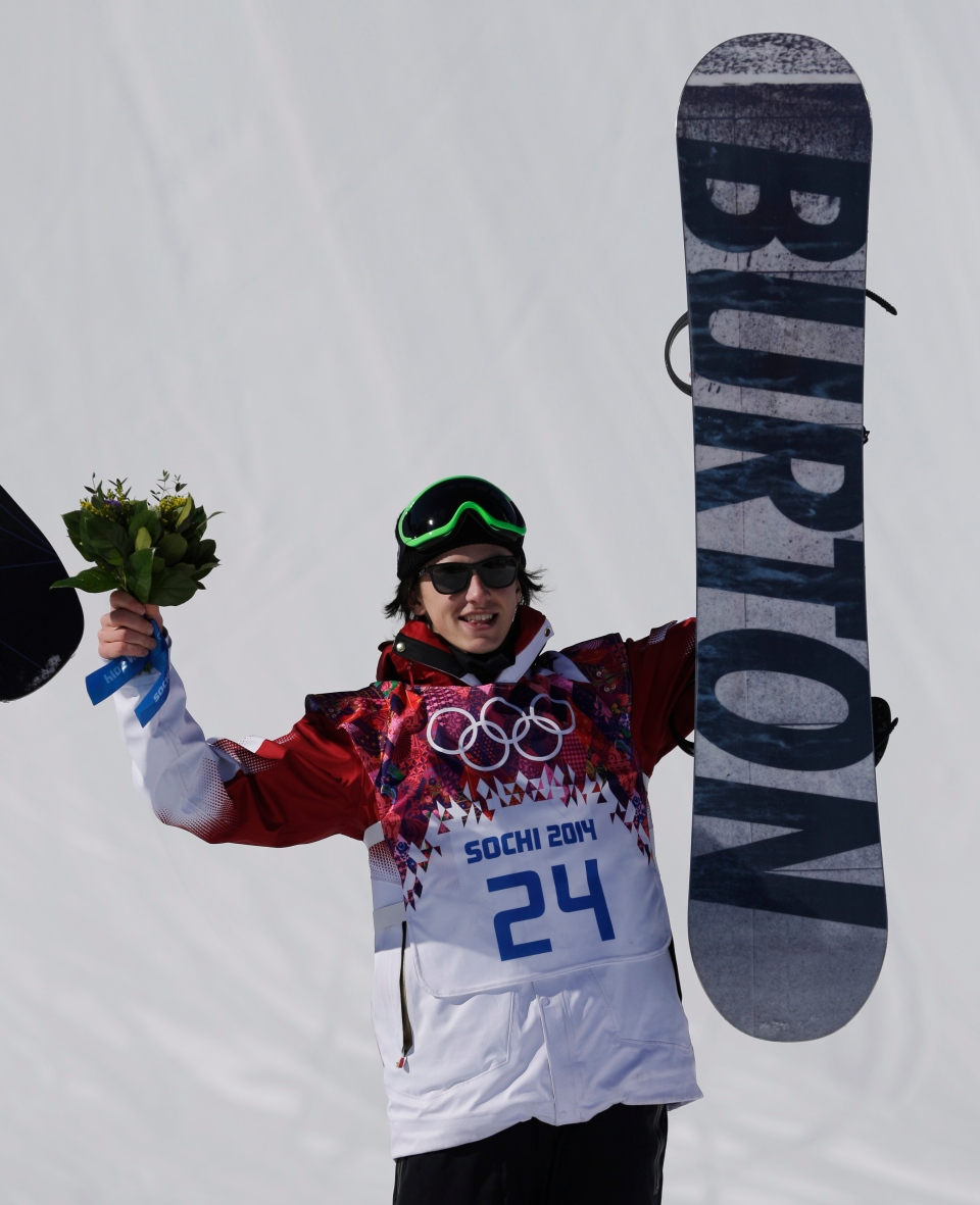 Canada's Mark McMorris celebrates on the podium after winning the bronze medal in the men's snowboard slopestyle final at the Rosa Khutor Extreme Park, at the 2014 Winter Olympics in Krasnaya Polyana, Russia, Saturday, Feb. 8, 2014 (AP / Andy Wong)