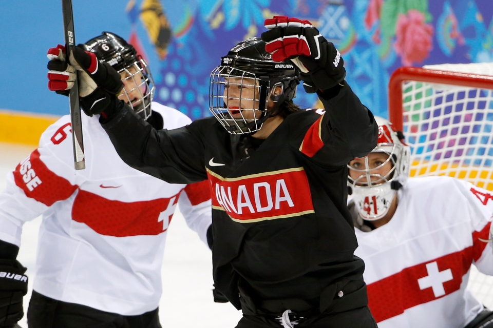 Tara Watchorn of Canada celebrates her goal as Julia Marty of Switzerland, left, and Goalkeeper Florence Schelling look on during the first period of the women's ice hockey game at the Shayba Arena during the 2014 Winter Olympics, Saturday, Feb. 8, 2014, in Sochi, Russia. (AP / Petr David Josek)