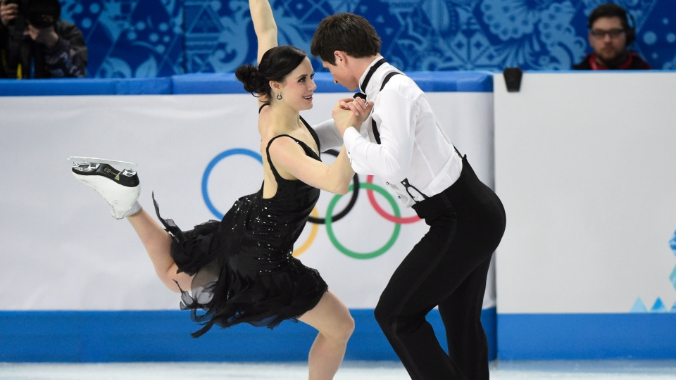 Canada's Tessa Virtue and Scott Moir perform their short dance in the ice dance portion of the team figure skating event at the Sochi Winter Olympics in Sochi, Saturday, Feb. 8, 2014. (Paul Chiasson / THE CANADIAN PRESS)