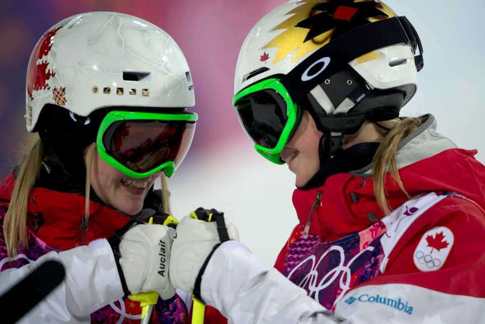 Canada's Justine Dufour-Lapointe (left) and sister Chloe Dufour-Lapointe bump fists as they are introduced for the finals women's moguls at the Sochi Winter Olympics Saturday February 8, 2014 in Polyana, Russia. (Adrian Wyld / THE CANADIAN PRESS)