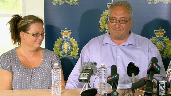 Paul Hebert speaks at a news conference in Sparwood, B.C. nest to his wife Tammy on Sunday, Sept. 11, 2011.