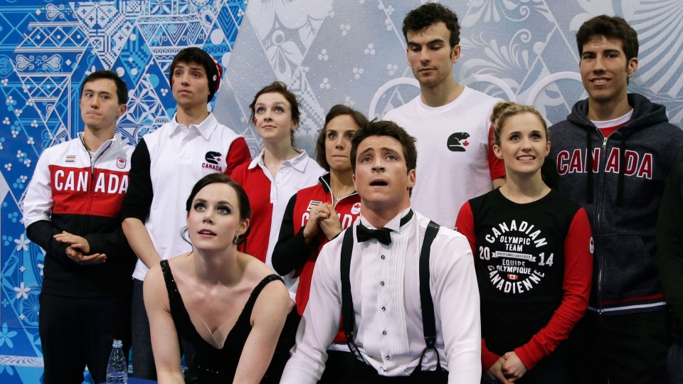 Tessa Virtue and Scott Moir of Canada wait for their results after competing in the team ice dance short dance figure skating competition at the Iceberg Skating Palace during the 2014 Winter Olympics, Saturday, Feb. 8, 2014, in Sochi, Russia. (AP / Darron Cummings)