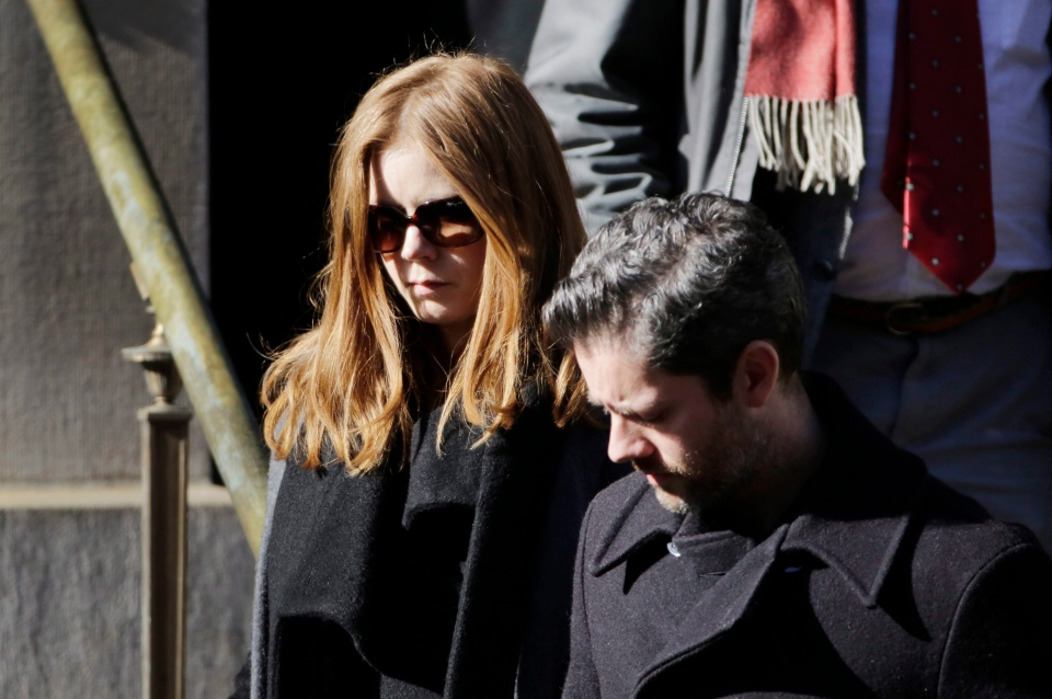 Actress Amy Adams and her fiance Darren Le Gallo leave the Church of St. Ignatius Loyola following the funeral for actor Philip Seymour Hoffman, Friday, Feb. 7, 2014 in New York. (AP / Mark Lennihan)