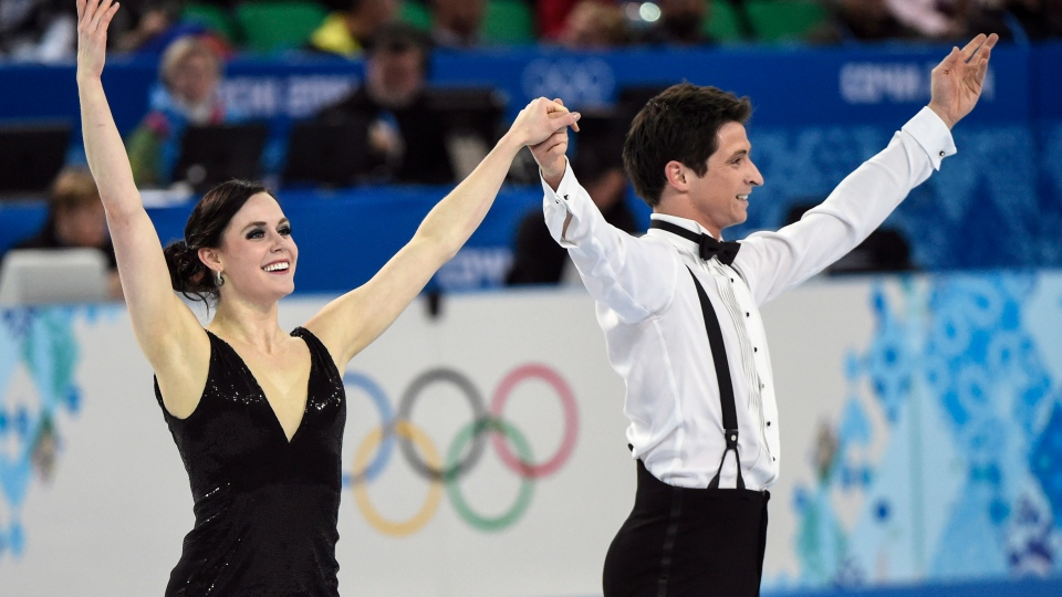 Canada's Tessa Virtue and Scott Moir perform their short dance in the ice dance portion of the team figure skating event at the Sochi Winter Olympics Saturday, February 8, 2014 in Sochi. (Paul Chiasson / THE CANADIAN PRESS)