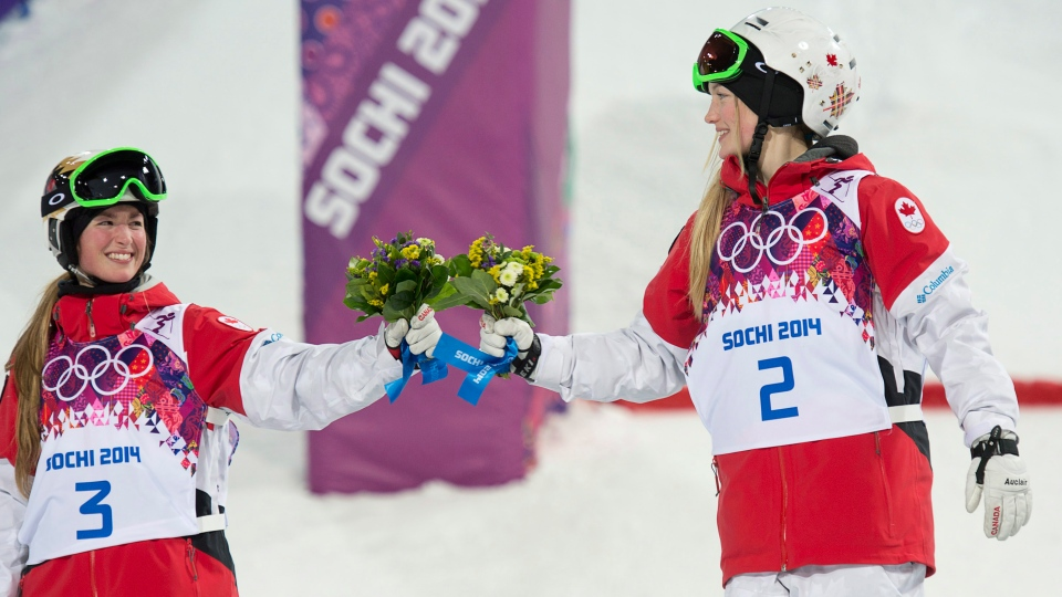 Canada's Justine Dufour-Lapointe (right) celebrates with her sister Chloe Dufour-Lapointe after winning the gold and silver medal respectively in the moguls at the Sochi Winter Olympics Saturday February 8, 2014 in Sochi, Russia. (Adrian Wyld / THE CANADIAN PRESS)