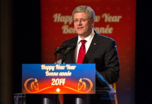 Canadian Prime Minister Stephen Harper addresses guests at the Confederation of Greater Toronto Chinese Business Association's Annual Lunar New Year Gala in Toronto on Saturday February 8, 2014. (Chris Young / THE CANADIAN PRESS)