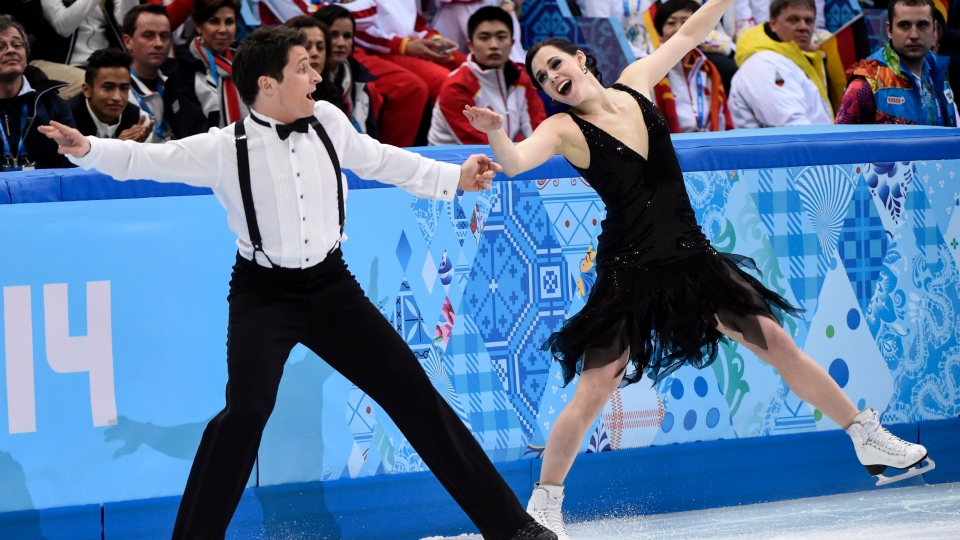 Canada's Tessa Virtue and Scott Moir perform their short dance in the ice dance portion of the team figure skating event at the Sochi Winter Olympics Saturday, February 8, 2014 in Sochi. (Paul Chaisson / THE CANADIAN PRESS)