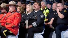 RCMP officers and first responders take part in a memorial ceremony Sunday, September 11, 2011, in Gander, N.L. (Ryan Remiorz / THE CANADIAN PRESS)