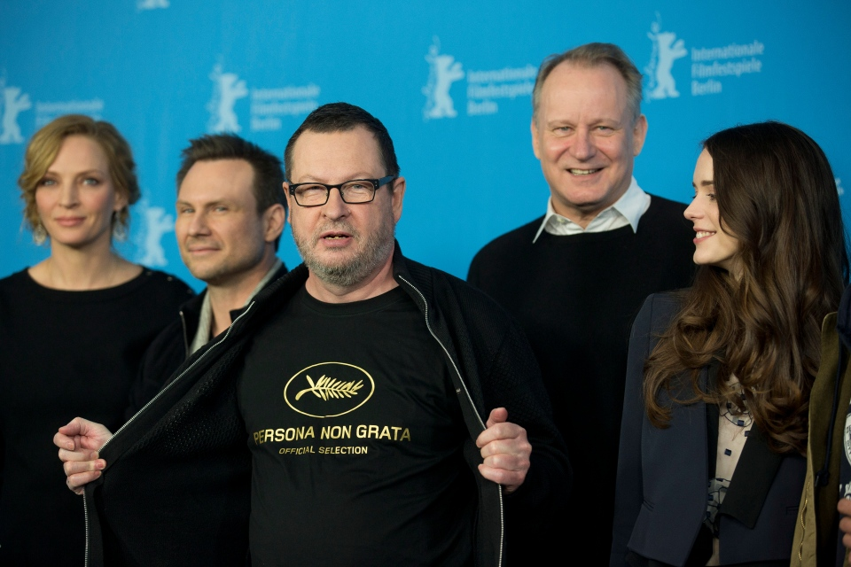 Director Lars von Trier, centre, reveals a tee shirt which has the Cannes film festival symbol and the slogan Persona Non Grata underneath as he poses for photographers at the photo call for the film Nymphomaniac at the International Film Festival Berlinale in Berlin, Sunday, Feb. 9, 2014. (AP / Axel Schmidt)